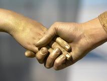 золотистое рукопожатие Стоковые Фото