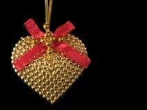 золотистое сердце Стоковые Фото