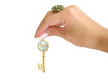 золотистой ключ изолированный рукой стоковая фотография