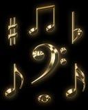 золотистые знаки нот Стоковые Изображения