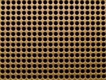 золотистые отверстия Стоковое Изображение