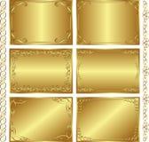 Золотистые предпосылки Стоковые Изображения