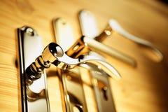 золотистые ручки Стоковые Изображения RF