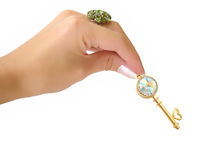 золотистый ключ руки Стоковое Изображение RF
