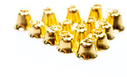 Золотистый колокол на белой предпосылке Стоковые Изображения RF
