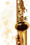 золотистый саксофон нот праздника Стоковое Фото