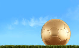 Золотистый шарик футбола Стоковая Фотография