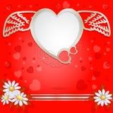 Золотое сердце с крылами и цветком Стоковые Фото