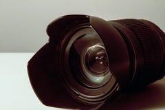 Золотой объектив фотоаппарата стоковые фотографии rf