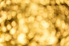 Золотой сверкнать и расплывчатая предпосылка для годовщины и знаменитости стоковое фото rf