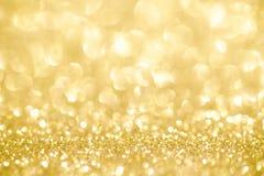 Золотой confetti текстуры яркого блеска shimmer конструировал предпосылку стоковое изображение