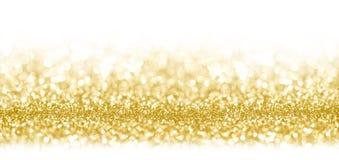 Золотой confetti текстуры яркого блеска shimmer конструировал предпосылку стоковое фото rf