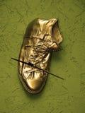 золото ботинка стоковые изображения