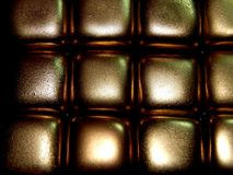 Золото в слитках золота на черной предпосылке Стоковая Фотография RF