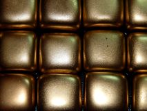 Золото в слитках золота на черной предпосылке Стоковые Изображения RF