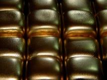 Золото в слитках золота на черной предпосылке Стоковая Фотография