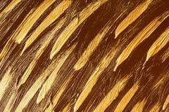 Золото и коричневые акриловые brushstrokes стоковые фото