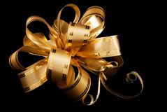 золото подарков смычка праздничное Стоковые Изображения