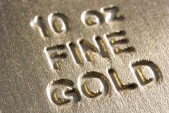 золото штанги близкое вверх стоковая фотография