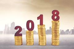 Золотые монетки с 2018 Стоковые Изображения