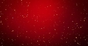 Золотые света confetti и bokeh на красной предпосылке веселого рождества видеоматериал