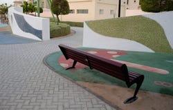 Зона скамейки в парке детей прорезиновая Стоковые Фотографии RF