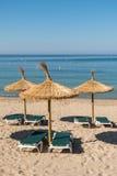 Зонтики и места на пляже Стоковое фото RF