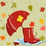 Зонтик, ботинки, и листья осени Стоковые Изображения