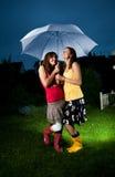 зонтик девушок вниз Стоковая Фотография RF
