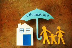Зонтик заботы Обамы семьи Стоковое Изображение