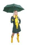 зонтик зеленого цвета девушки пальто Стоковое Фото