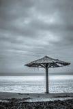 Зонтик и замороженное озеро Стоковая Фотография RF