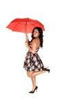 зонтик красного цвета девушки Стоковые Изображения