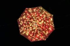 Зонтик оранжевого красного цвета загоренный Стоковые Фотографии RF