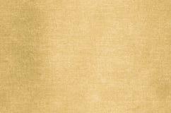 Золотая абстрактная текстура покрашенная на предпосылке холста искусства Стоковое Изображение