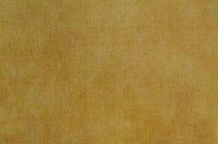 Золотая абстрактная текстура покрашенная на предпосылке холста искусства Стоковые Изображения
