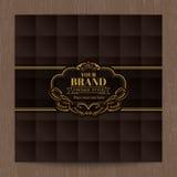 Золотая винтажная овальная рамка на коричневом квадратном виде решетки Стоковые Изображения RF