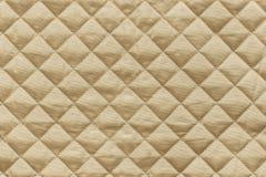 Золотая выстеганная ткань с grained текстурой Стоковые Фото