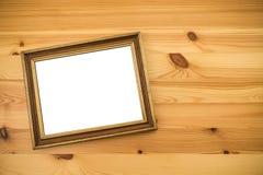 Золотая деревянная рамка фото на таблице Насмешка вверх Стоковые Фото