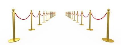 Золотая загородка, опора с красной веревочкой барьера Стоковые Фото
