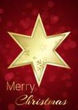 Золотая звезда рождества на красной предпосылке Bokeh Стоковая Фотография