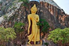 Золотая каменная статуя Будды Стоковая Фотография RF