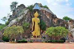 Золотая каменная статуя Будды Стоковое Изображение