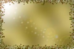 Золотая коричневая предпосылка с границей листьев, травы и пирофакела Стоковые Фотографии RF