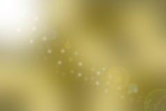 Золотая коричневая предпосылка с лучами солнца и объектив flare Стоковое Изображение