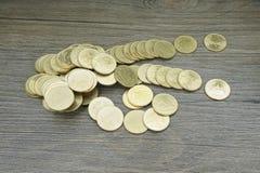 Золотая монетка тайского бата рассеивает Стоковое Изображение