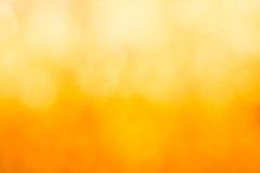 Золотая предпосылка конспекта нерезкости bokeh Стоковая Фотография RF