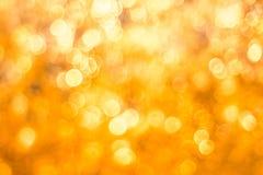 Золотая предпосылка конспекта нерезкости bokeh Стоковые Фото