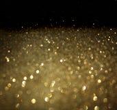 Золотая предпосылка defocused абстрактных светов. золотые света bokeh. Стоковые Фотографии RF