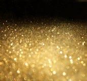 Золотая предпосылка defocused абстрактных светов. золотые света bokeh. Стоковая Фотография RF